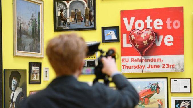 "A man films ""Vote to Love"" by Banksy (£350m)"
