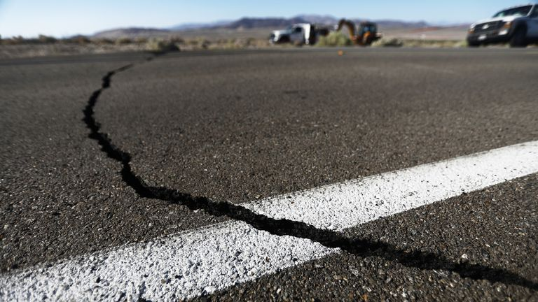 RIDGECREST, CALIFORNIA - JULY 04:  A crack stretches across the road after a 6.4 magnitude earthquake struck the area on July 4, 2019 near Ridgecrest, California. The earthquake was the largest to strike Southern California in 20 years with the epicenter located in a remote area of the Mojave Desert. The temblor was felt by residents across much of Southern California. (Photo by Mario Tama/Getty Images)
