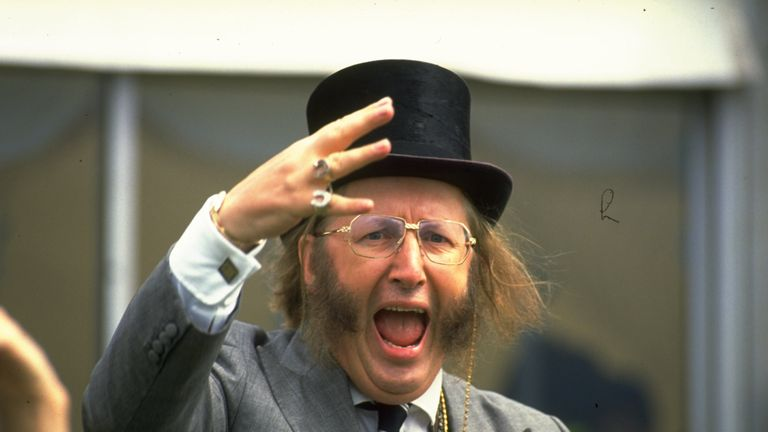 1990:  John McCririck a television Channel Four commentator doing his version of the Tic Tac at the Epsom Derby.                Mandatory Credit: Allsport  UK/Allsport