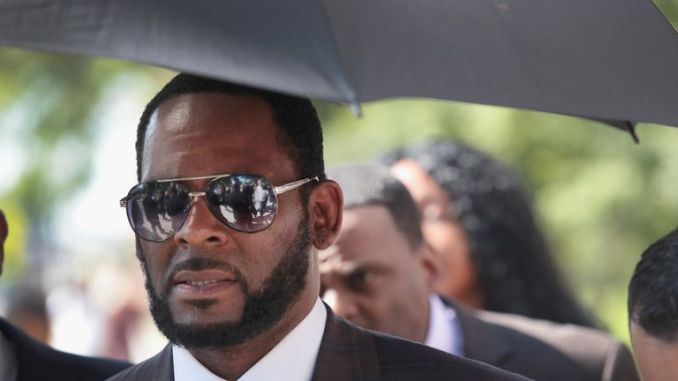 CHICAGO, ILLINOIS - JUNE 26: R&B singer R. Kelly leaves the Leighton Criminal Courts Building following a hearing on June 26, 2019 in Chicago, Illinois. Prosecutors turned over to Kelly's defense team a DVD that alleges to show Kelly having sex with an underage girl in the 1990s. Kelly has been charged with multiple sex crimes involving four women, three of whom were underage at the time of the alleged encounters.   (Photo by Scott Olson/Getty Images)