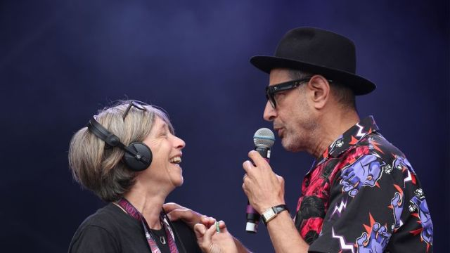 Actor Jeff Goldblum jokes around with a stage technician ahead of his performance with the Mildred Snitzer Orchestra at the West Holts Stage during the fifth day of the Glastonbury Festival at Worthy Farm in Somerset. PRESS ASSOCIATION Photo. Picture date: Sunday June 30, 2019. See PA story SHOWBIZ Glastonbury. Photo credit should read: Yui Mok/PA Wire