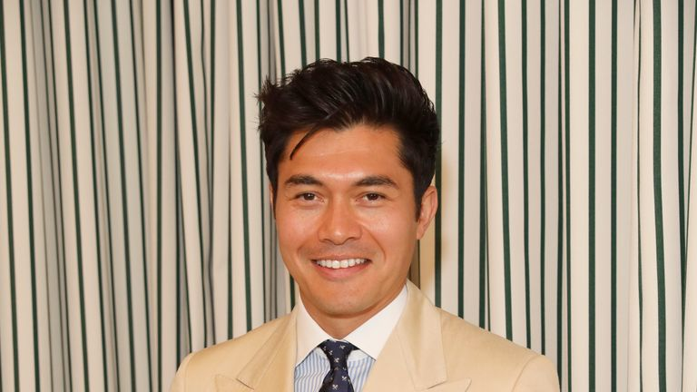LONDON, ENGLAND - JULY 14: Henry Golding in Ralph Lauren Purple Label attends the Polo Ralph Lauren suite during the Wimbledon Tennis Championship Men's Final at All England Lawn Tennis and Croquet Club on July 14, 2019 in London, England. (Photo by Darren Gerrish/WireImage)