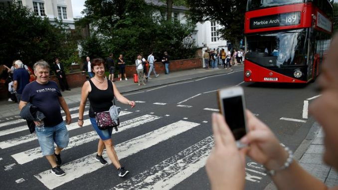 Tourists capture pictures of the Abbey Road zebra crossing