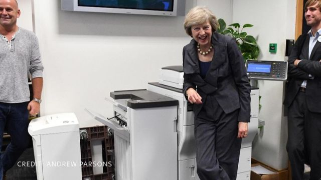 Theresa May having a laugh. Pic: Andrew Parsons