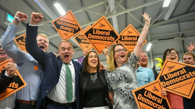 Liberal Democrat MP Jane Dodds, centre, celebrates with supporters