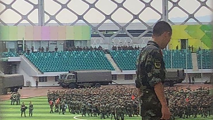Chinese military personnel gather inside Shenzhen Bay stadium in Shenzhen, bordering Hong Kong