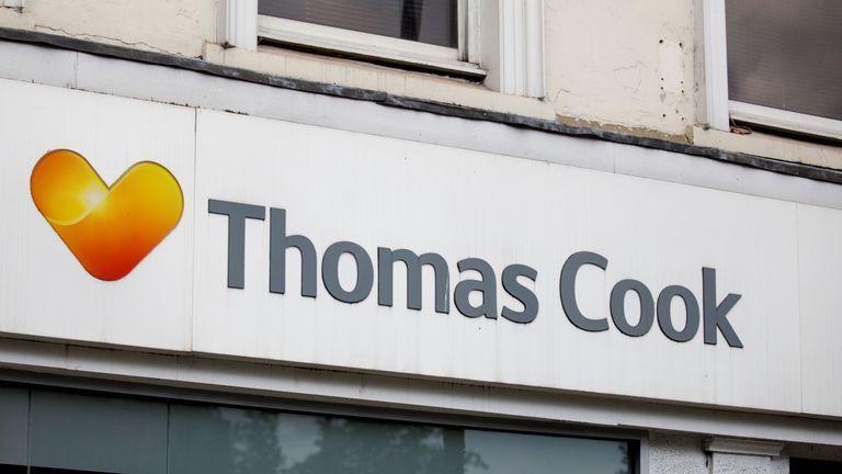 """A sign is pictured above a branch of a Thomas Cook travel agent's shop in London on July 12, 2019. - China's Fosun Group is considering nearly a billion dollar rescue of embattled British tour operator Thomas Cook, the Hong Kong-listed conglomerate confirmed Friday. The Chinese company said in a stock market announcement that there are """"ongoing advanced discussions"""" about a capital injection which would see a debt-for-equity swap at the British travel agency, which has struggled with its debt pile. (Photo by Tolga Akmen / various sources / AFP)        (Photo credit should read TOLGA AKMEN/AFP/Getty Images)"""