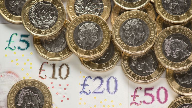 EMBARGOED TO 0001 MONDAY 29 JULY File photo dated 26/01/2018 of banknotes and coins. The national living wage has helped raise wages for the self-employed even though they are not eligible to receive it, according to a new study.