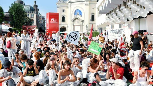 The 76th Venice Film Festival - Venice, Italy, September 7, 2019 - Climate activists are seen on a red carpet