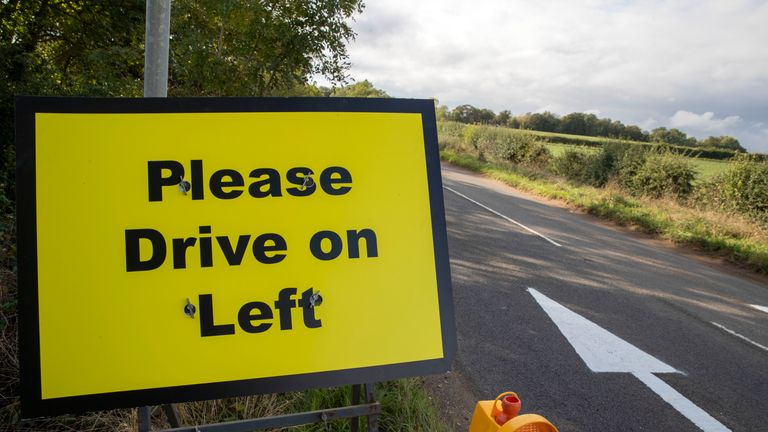 Please Drive on Left signs and arrows have been placed on the B4031 road outside RAF Croughton, in Northamptonshire, where Harry Dunn, 19, died when his motorbike was involved in a head-on collision in August.