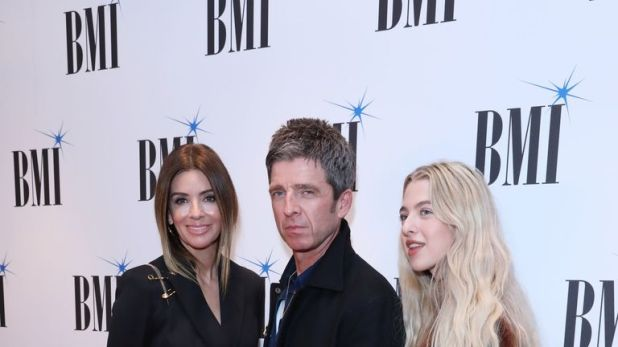 Noel Gallagher supported by wife (left) Sara MacDonald and daughter Anais Gallagher attending the BMI London Awards 2019 at the Savoy Hotel in London. PA Photo. Picture date: Monday October 21, 2019