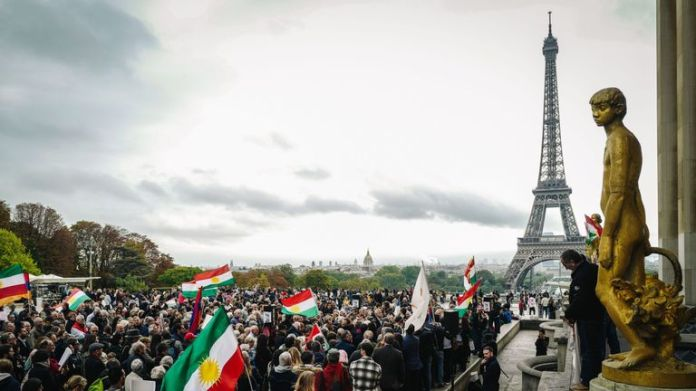 People take part in a demonstration on the human rights square in Paris on October 12, 2019 to support Kurdish militants as Turkey continues its assault on the Kurdish-held border towns in the north-eastern part of the country. Syria today, on the fourth day of an offensive that fires growing international condemnation, even from Washington