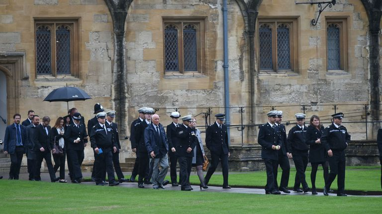 Mourners arrive at the service in Oxford