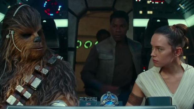 Rey in the cockpit of the Millennium Falcon with Chewbacca and Finn