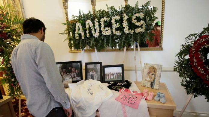 A person observes framed photographs of Rhonita Maria Miller and her four children, members of the Mexican-American Mormon community, killed by unknown assailants, before her funeral at La Mora, La Mora, State of Sonora, Mexico, on 7 November 2019. REUTERS / Jose Luis Gonzalez