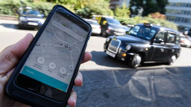 """LONDON, ENGLAND - SEPTEMBER 22: In this Photo Illustration, a phone displays the Uber ride-hailing app on September 22, 2017 in London, England. The Transport Regulator has announced that it will not re-new the company's licence to operate in London as it's current service is """"not fit and proper"""". (Photo by Leon Neal/Getty Images)"""