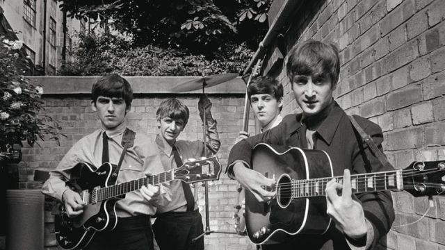 The Beatles during the recording of their first hit single and album 'Please Please Me'. Pic: Terry O'Neill/Iconic Images