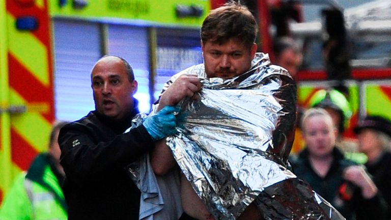 TOPSHOT - Police assist an injured man near London Bridge in London, on November 29, 2019 after reports of shots being fired on London Bridge. - The Metropolitan Police on Friday said several people were injured and a man was held after a stabbing near London Bridge in the centre of the British capital. (Photo by DANIEL SORABJI / AFP) (Photo by DANIEL SORABJI/AFP via Getty Images)