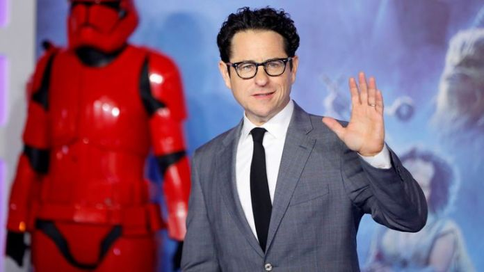 Film director JJ Abrams poses on the red carpet upon arrival for the European film premiere of Star Wars: The Rise of Skywalker