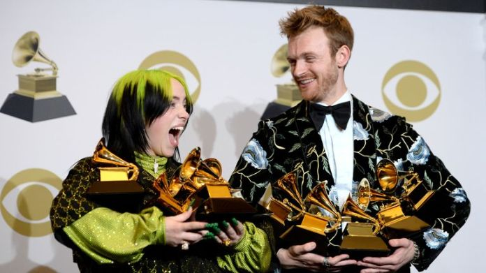 "Billie Eilish, winner of Record of the Year for ""Bad Guy"", Album of the Year for ""when we all fall asleep, where do we go?"", Song of the Year for ""Bad Guy"", Best New Artist and Best Pop Vocal Album for ""when we all fall asleep, where do we go?"", and Finneas O'Connell, winner of Best Engineered Album Non-Classical for ""when we all fall asleep, where do we go?"", Song of the Year for ""Bad Guy"", and Producer Of The Year Non-Classical pose in the press room during the 62nd Annual GRAMMY Awards at STA"
