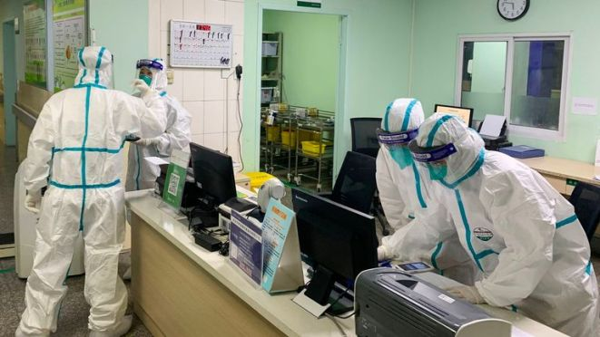 Medical staff wearing protective suits at the Zhongnan hospital in Wuhan in China's central Hubei province