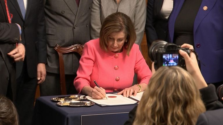 Nancy Pelosi signs article of impeachment against president Trump
