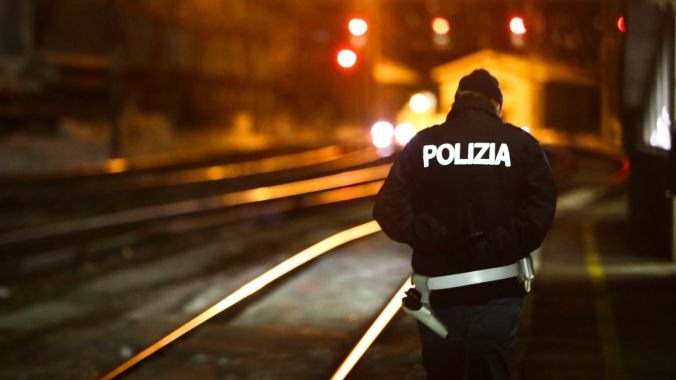 A police officer patrols on a platform at the train station on the Italian side of the Brenner Pass, Italy