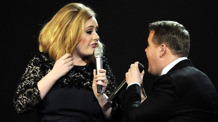Adele is interrupted by James Corden as she accepts her award in 2012. Photo: Dave M. Benett / Getty Images