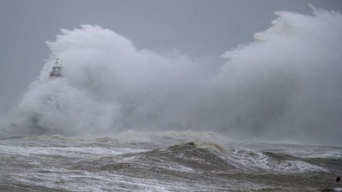 Huge waves engulf a lighthouse in Newhaven during the Ciara storm