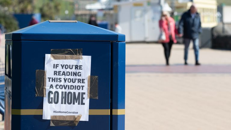 "A sign warning visitors to ""Go Home"" at Barry Island on March 25, 2020 in Barry, United Kingdom. The Coronavirus (COVID-19) pandemic has spread to at least 182 countries, claiming over 18,000 lives and infecting hundreds of thousands more"