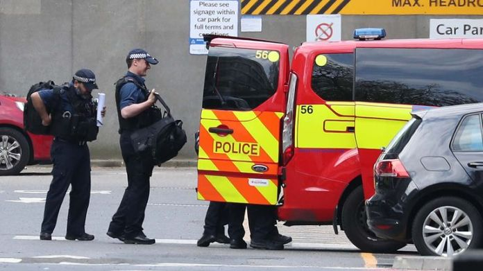 Armed police were seen leaving hospital after PM's discharge