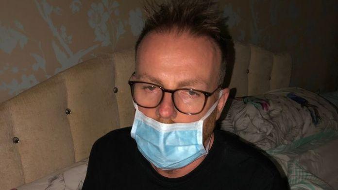 Darren Buttrick, seen after returning from hospital