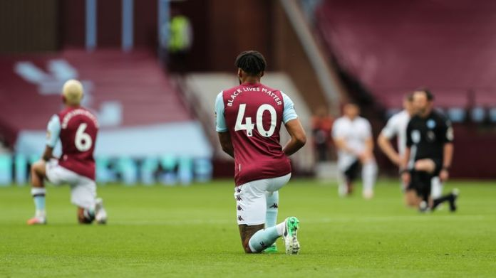 Aston Villa players take a knee in support of the Black Lives Matter campaign