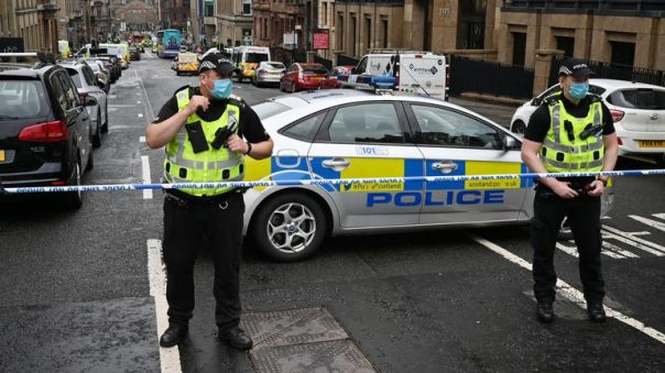 GLASGOW, SCOTLAND - JUNE 26: Police officers at the scene after reports of three people being killed in a central Glasgow hotel on June 26, 2020 in Glasgow, Scotland. A knifeman stabbed three people to death in the stairwell of the Park Inn Hotel on West George Street, Glasgow before being shot himself by armed police. The Scottish Police Federation (SPF) said an officer was stabbed during the major incident. (Photo by Jeff J Mitchell/Getty Images)