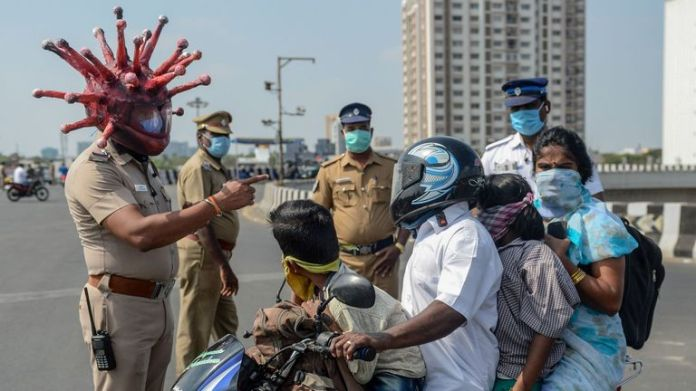 Some Indian police officers wear coronavirus-themed helmets