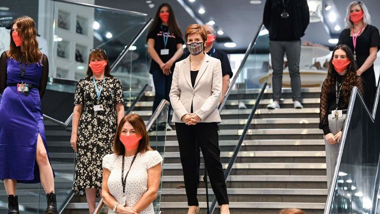 Scotland's First Minister, Nicola Sturgeon wears a Tartan face mask as she visits New Look at Ford Kinaird Retail Park in Edinburgh on June 26, 2020, as Scotland prepares for a further loosening of the COVID-19 lockdown, easing travel restrictions and allowing the re-opening of retailers. (Photo by Jeff J Mitchell / POOL / AFP) (Photo by JEFF J MITCHELL/POOL/AFP via Getty Images)