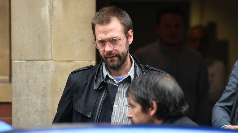 Ex-Kasabian singer Tom Meighan leaving Leicester Magistrates' Court where he was sentenced to carry out 200 hours of unpaid work for assaulting former fiancee Vikki Ager.