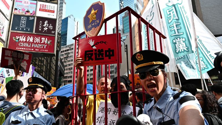 TOPSHOT - Activists attend a protest in Hong Kong on April 28, 2019, against a controversial move by the government to allow extraditions to the Chinese mainland. - Hong Kong's government has recently announced plans to overhaul its extradition rules, allowing the transfer of fugitives with Taiwan, Macau and mainland China on a