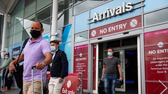 Passengers flying from Malaga arrive at Birmingham Airport, following an announcement on Saturday that holidaymakers who had not returned from Spain and its islands by midnight would be forced to quarantine for 14 days after Covid-19 second wave fears saw the European country struck off the UK's safe list. The decision was made after Spain recorded more than 900 fresh daily Covid-19 cases for two days running.