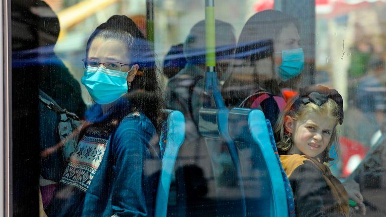 People wear masks on a train in central Jerusalem