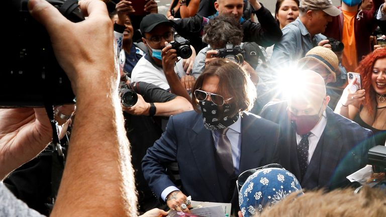 Johnny Depp arrives at the High Court a little later than usual on 17 July