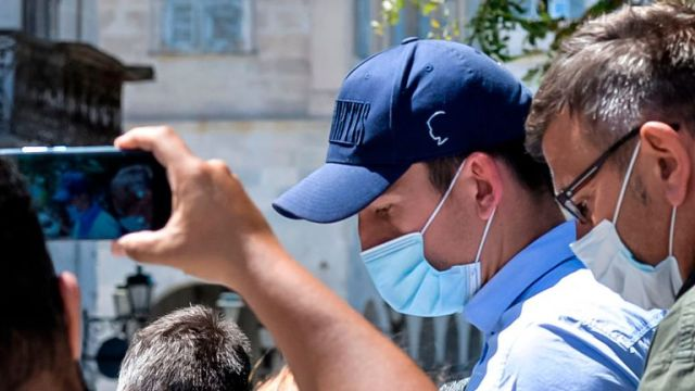 """Manchester United football team captain Harry Maguire leaves a courthouse on the Greek island of Syros, the administrative hub of the Cycladic island group that includes Mykonos on August 22, 2020. - Maguire was released from Greek police custody on August 22, 2020, TV footage showed, pending a hearing on assault charges on the neighbouring island of Mykonos. The £80 million (88 million euros) defender was arrested late on August 20, after what Greek police described as an """"altercation"""" between two groups of British tourists on Mykonos. (Photo by EUROKINISSI / AFP) (Photo by EUROKINISSI/AFP via Getty Images)"""