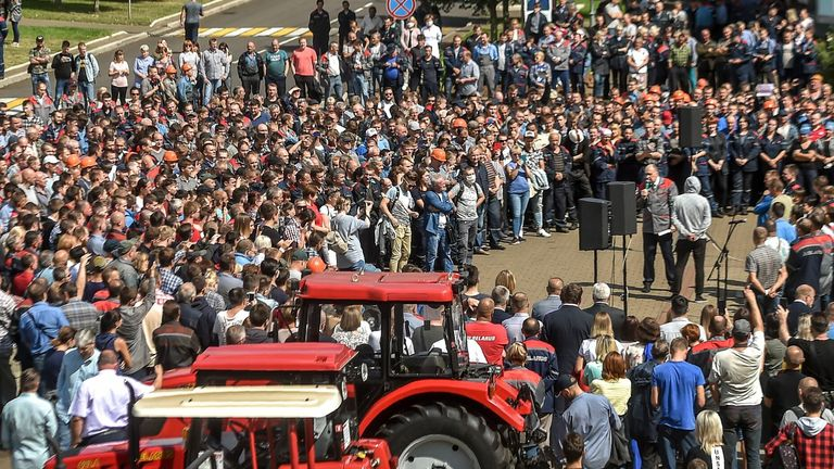 TOPSHOT - General director of Minsk tractor plant (MTZ) Fedor Domotenko (C) addresses employees during a rally to express their solidarity with recent rallies of opposition supporters, who accuse strongman Alexander Lukashenko of falsifying the polls in the presidential election in Minsk, on August 14, 2020. (Photo by Sergei GAPON / AFP) (Photo by SERGEI GAPON/AFP via Getty Images)