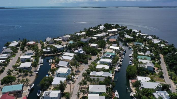 defaultKEY LARGO, FLORIDA - JULY 08: In this aerial photo from a drone, a neighborhood is seen on July 8, 2020 in Key Largo, Florida. 11 cases of the dengue fever have been confirmed in the Florida Keys and all have been in Key Largo. The disease is transmitted through the bite of the female Aedes aegypti mosquito. Officials from the Florida Keys Mosquito Control are asking residents to help stop the spread of the disease by eliminating potential Aedes aegypti breeding grounds.