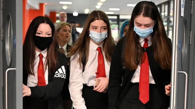 GLASGOW, SCOTLAND - AUGUST 12: Pupils return to St Paul's High School for the first time since the start of the coronavirus lockdown nearly five months ago on August 12, 2020 in Glasgow, Scotland. Pupils will return to more of Scotland's schools today, as the fallout continues from the governments decision to upgrade exam results. (Photo by Jeff J Mitchell/Getty Images)