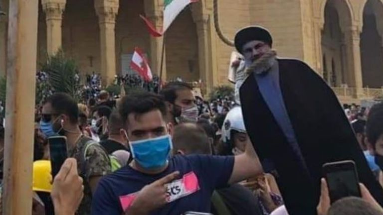 A cardboard cutout of Hezbollah leader Hassan Nasrallah is placed in a noose
