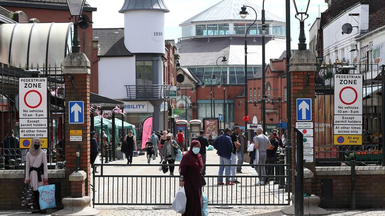 People shopping in Oldham, where there has been a rise in infections