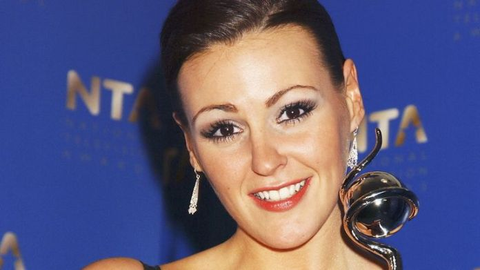 Coronation Street actress Suranne Jones poses in the awards room with the award for best actress at the