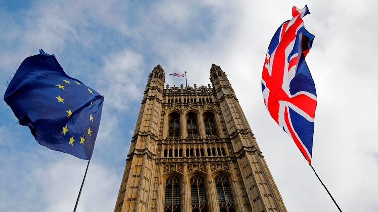 EU and Union flags flutter in the breeze in front of the Victoria Tower, part of the Palace of Westminster in central London on October 17, 2019. - Britain's Prime Minister Boris Johnson and the European Union on Thursday reached a provisional agreement that might just see Britain leave the European Union by the October 31 deadline. (Photo by Tolga AKMEN / AFP) (Photo by TOLGA AKMEN/AFP via Getty Images)