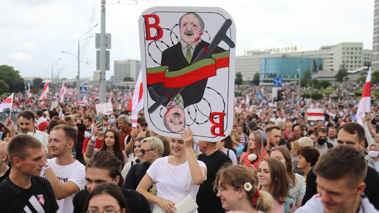 Belarus opposition supporters marching through the city